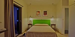 A bed or beds in a room at Elaia Villas
