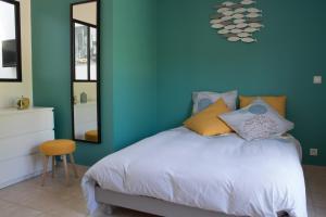 Un ou plusieurs lits dans un hébergement de l'établissement Le loft du Clos d'Esquay