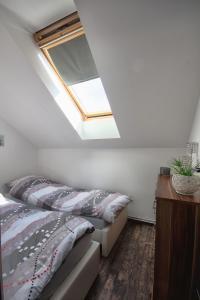 Łóżko lub łóżka w pokoju w obiekcie Apartament SunForYou