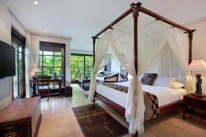 A bed or beds in a room at The Damai