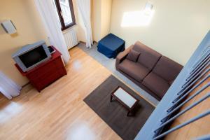 Télévision ou salle de divertissement dans l'établissement Belvedere Apartments on Como Lake