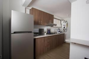 A kitchen or kitchenette at HomFor Napoles