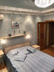 A bed or beds in a room at Аpartment on Richard Sorge