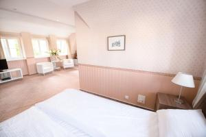 A bed or beds in a room at Apartamenty nad Motławą III