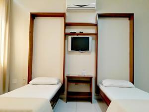Cama ou camas em um quarto em Carina Flat Santos by Atlantica Hotels
