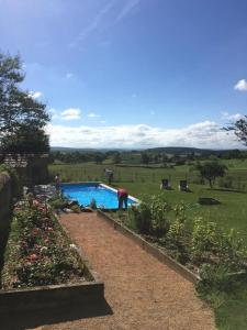A view of the pool at Gites La Tourelle or nearby