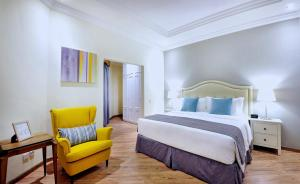 A bed or beds in a room at Spectrums Residence Managed by The Ascott Limited