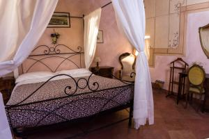 Letto o letti in una camera di Antica Toscana