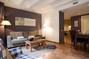 Ein Sitzbereich in der Unterkunft Apartments Barcelona & Home Deco Columbus