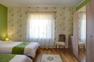 Gulta vai gultas numurā naktsmītnē Siili Holiday House