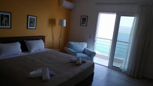 A bed or beds in a room at Aegean View Villa