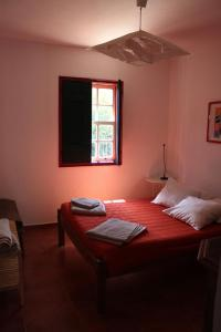 A bed or beds in a room at Casa As Gêmeas