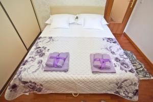 A bed or beds in a room at TERA Apartment near Bačvice beach