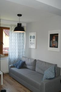 A seating area at Apartament Gratka
