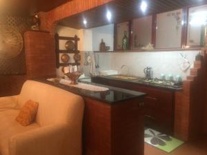A kitchen or kitchenette at Villa maria