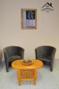 A seating area at Center Apartman - Paks