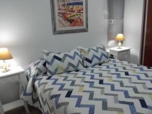"""Una cama o camas en una habitación de """"Los Abrojos"""" 1"""