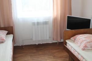 Кровать или кровати в номере Неман