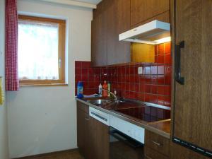 A kitchen or kitchenette at Azur