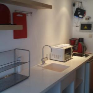 Cuisine ou kitchenette dans l'établissement Apartment BeFlats