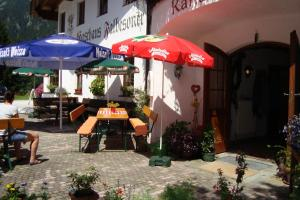 A restaurant or other place to eat at Gasthaus Falbesoner