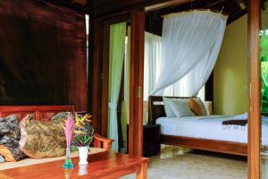 A bed or beds in a room at Prama House