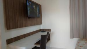 A television and/or entertainment center at Flats Lacqua Diroma