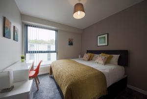 A bed or beds in a room at ByEvo Glasgow Airport Apartment 6