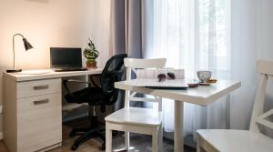 A television and/or entertainment center at Apartamenty Platinia