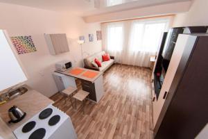 Гостиная зона в Nine Nights Apartments on Ermaka 10