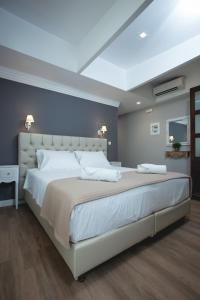 A bed or beds in a room at Nival Luxury Suites