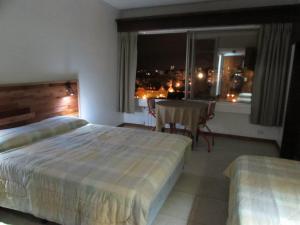 Una cama o camas en una habitación de Departamento turistico Bariloche