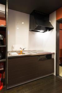 A kitchen or kitchenette at MUSUBI HOTEL Kyoto Sanjo Villa