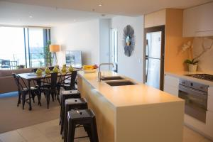 A kitchen or kitchenette at Ambience on Burleigh Beach