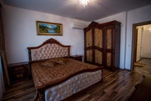A bed or beds in a room at Boutique Apart Hotel Versis