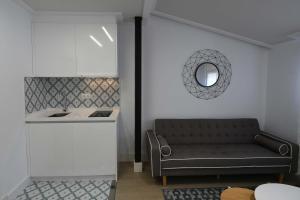 Una cocina o zona de cocina en LEÓN SUITE Urban Studios