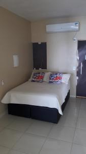 Cama ou camas em um quarto em Ocean Green Flats