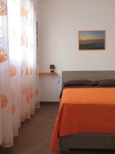 A bed or beds in a room at Colori di Sicilia