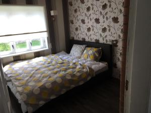 A bed or beds in a room at Ranna Apartment