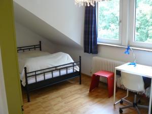 En eller flere senger på et rom på Ferienwohnung Weiken
