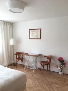 A seating area at House Apartmentshumpolec + Garden