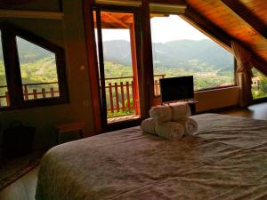 A bed or beds in a room at Oresivio