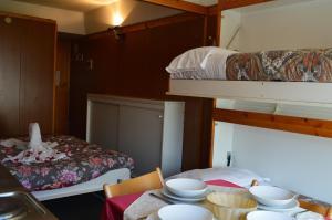 A bunk bed or bunk beds in a room at Il Vigo di Marilleva
