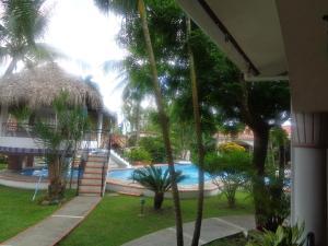 Der Swimmingpool an oder in der Nähe von Residencial Las Tejas