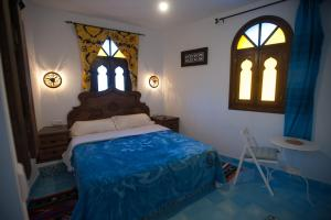 A bed or beds in a room at Dar Swiar