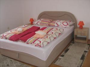 A bed or beds in a room at Apartment Jopa