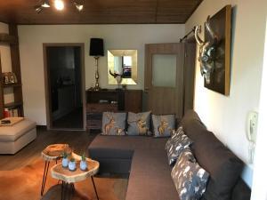 A seating area at Wachtelhof Apartment