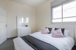 מיטה או מיטות בחדר ב-Villa Pentcho - StayFirstclass