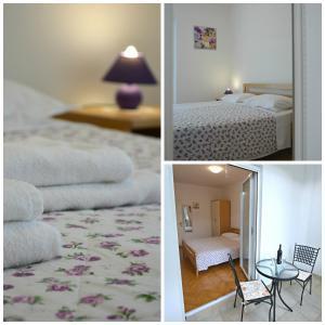 Postel nebo postele na pokoji v ubytování San Apartment