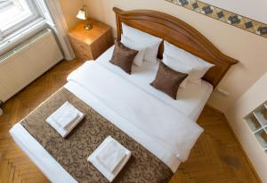 A bed or beds in a room at Budapest Best Apartments
